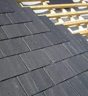Part way through a slate roof in Wirral